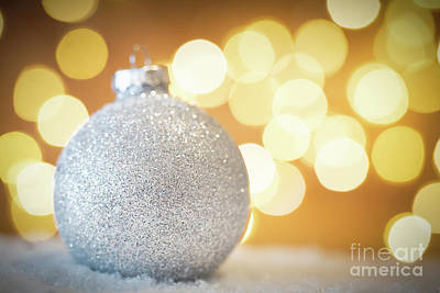 Photograph - Christmas Glass Ball In Snow. Glitter Lights Background by Michal Bednarek