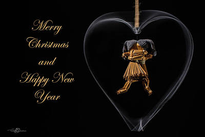 Photograph - Christmas Greeting With Dancing Straw Dolls In A Heart by Torbjorn Swenelius