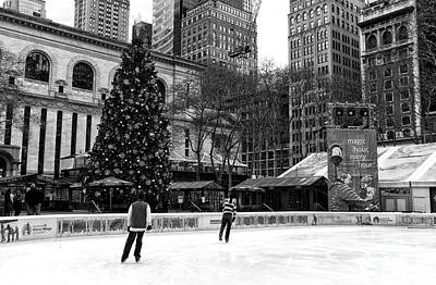 Christmas Ice Skating Art Print by John Rizzuto