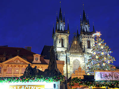 Photograph - Christmas Star In Old Town Square Prague by John Rizzuto