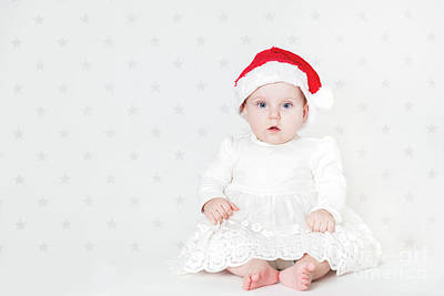 Photograph - Christmas Time. Cute Baby Sitting Wearing Cute Santa Hat And White Dress. by Michal Bednarek