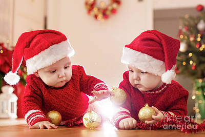 Photograph - Christmas Time. Cute Baby Twin Sisters Play With Glass Balls. by Michal Bednarek