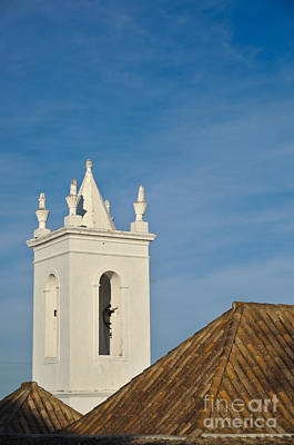 Church Bell Tower Behind Tiled Roofs In Tavira Art Print by Angelo DeVal