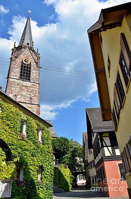 Church Tower Between Houses Art Print
