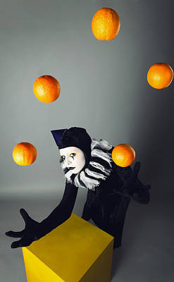 Circus Fashion Mime Juggles With Five Oranges. Photo. Original