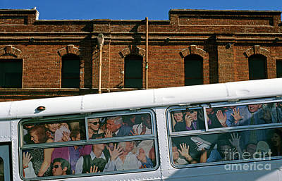Photograph - City Bus Ad With People Stuffed Into Bus  by Jim Corwin