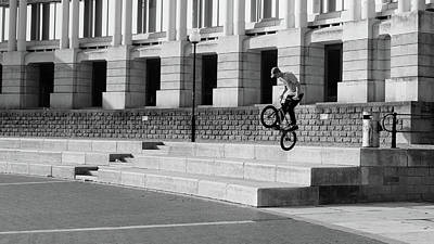 Photograph - City Life In Bristol, Tennager Practising Tricks On His Bike by Jacek Wojnarowski