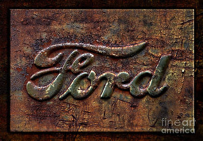 Photograph - Classic Rusty Ford Pickup Truck Logo Detail by John Stephens