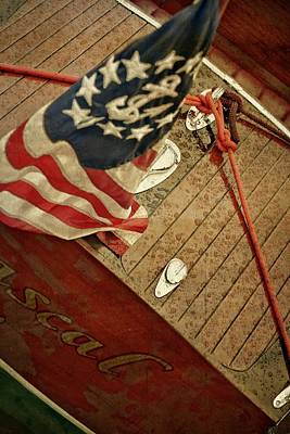 Photograph - Classic Wooden Boat Stern With Flag by Michelle Calkins