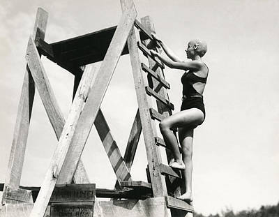 Swim Ladder Photograph - Climbing Up The High Dive by Underwood Archives