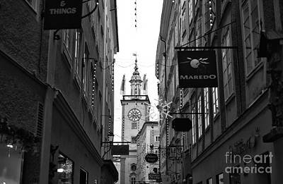 Photograph - Clock Tower Between The Buildings by John Rizzuto