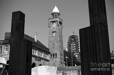 Photograph - Clock Tower In Hamburg Mono by John Rizzuto