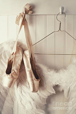 Photograph - Close Up Of Angel Wings And Ballet Slippers Hanging On Coat Hook by Sandra Cunningham