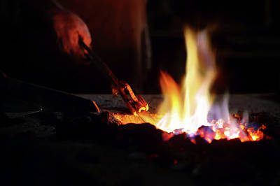 Blacksmiths Photograph - Close-up Of Hand  Heating Iron In Furnace by Johan Swanepoel