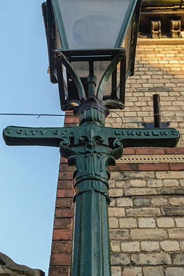 Photograph - Close Up Of Lincoln Lamp Post by Jacek Wojnarowski