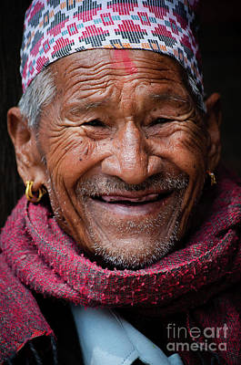 Photograph - Close Up Portrait Of Smiling Man In Nepal by Global Light Photography - Nicole Leffer
