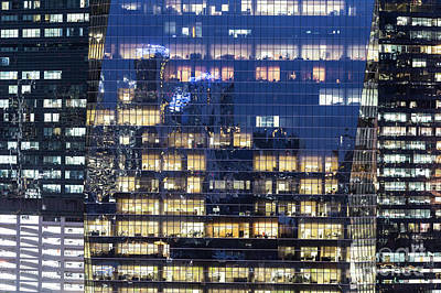 Photograph - Close Up View Of 3 Different Office Building Facade At Night In  by Didier Marti