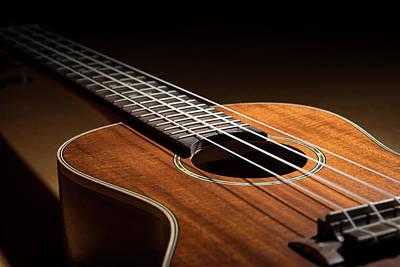 Concert Ukulele Photograph - Closeup Of A Small Guitar Ukulele Low Key by Stefan Rotter
