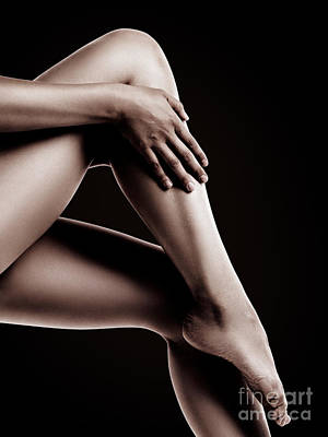 Closeup Of Bare Woman Legs On Black Background Art Print