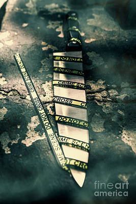 Crime Photograph - Closeup Of Knife Wrapped With Do Not Cross Tape On Floor by Jorgo Photography - Wall Art Gallery