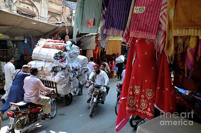 Photograph - Cloth Shops Inside Traditional Bazaar Market In Walled City Lahore Pakistan by Imran Ahmed