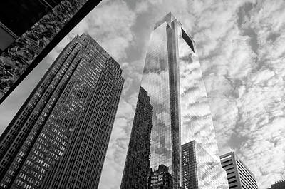 Photograph - Cloud Refelctions On The Comcarst Center In Black And White by Bill Cannon