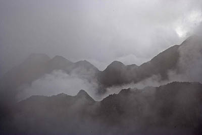 Natural Forces Photograph - Cloud Shrouded Machu Picchu by Michael Melford