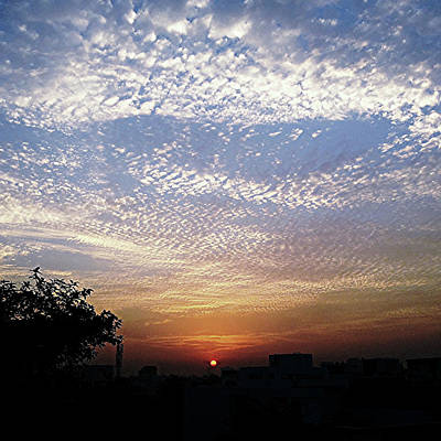 Cloud Swirl At Sunrise Art Print