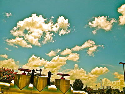 Clouds Over Oil Field Equipent Art Print by Chuck Taylor
