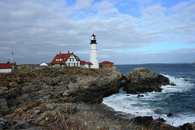 Clouds Over Portland Head Lighthouse Art Print by Lou Ford