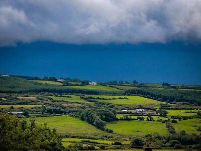 Photograph - Clouds Over Shimmering Green Irish Countryside by James Truett