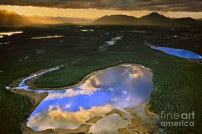 Photograph - Clouds Reflecting In Lake, Alaska, Usa by Frans Lanting/MINT Images