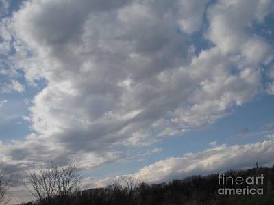 Clouds Rolling Back Art Print by Deborah Finley