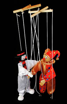 Clown Marionettes Shaking Hands On A Black Background With Suspe Art Print by Reimar Gaertner