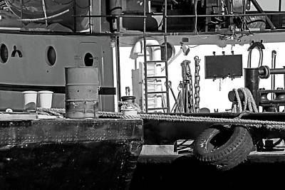 Photograph - Cluttered Dock And Boat Bw by Mary Bedy