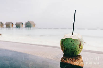 Photograph - Coconut With A Straw Standing. Ocean View by Michal Bednarek