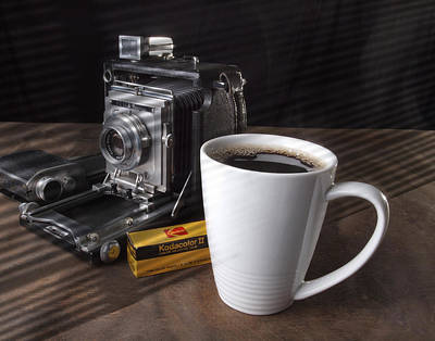 Photograph - Coffe Cup And Camera by Gary De Capua