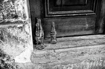Photograph - Coke Bottles On The Stoop Mono by John Rizzuto