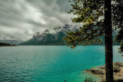 Food And Flowers Still Life Rights Managed Images - Cold Morning On Lake Minnewanka Royalty-Free Image by Karl Anderson