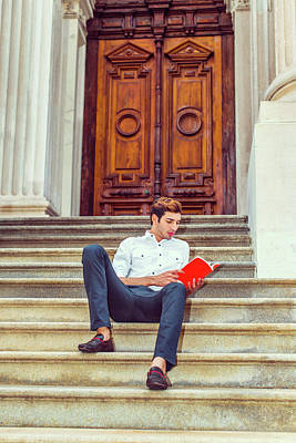 Photograph - College Student Reading Red Book, Sitting On Stairs, Relaxing Ou by Alexander Image