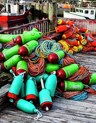 Photograph - Colorful Buoys On The Wharf, Peggy's Cove by Carol Leigh