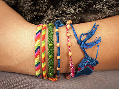 Keith Richards - Colorful friendship bracelet on a childs hand by Stefan Rotter