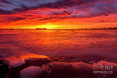 Photograph - Colorful Sunrise Or Sunset On A Frozen Lake With Rocks In The Fo by Ronda Kimbrow