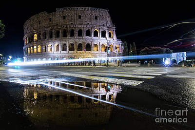 Photograph - Colosseum with trail lights by Paolo Sirtori