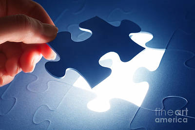 Completing The Last Piece Of Jigsaw Puzzle Art Print by Michal Bednarek