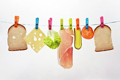 Components Of Sandwich Pegged To Washing Line Art Print by Image by Catherine MacBride