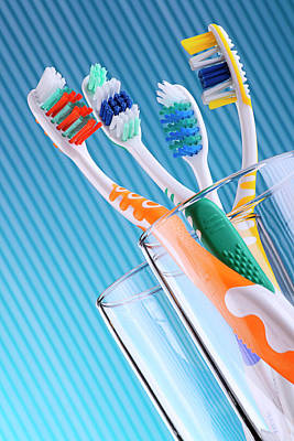 Composition With Four Toothbrushes On Blue Background  Original