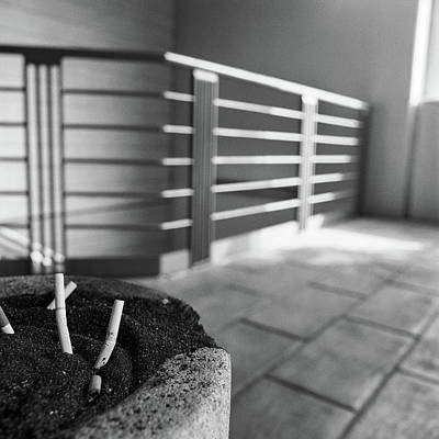 Photograph - Concrete Ashtray Close Up Cigarette Butts  by YoPedro