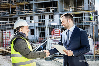 Photograph - Construction Engineer And Investor Handshake by Michal Bednarek