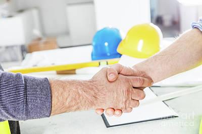 Photograph - Construction Engineers Handshake. by Michal Bednarek